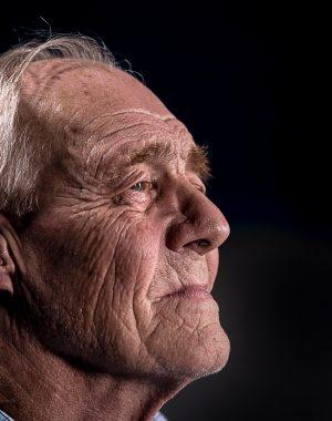 Older man wearing in ear hearing aid